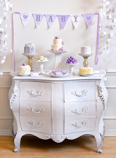baby love baby shower dessert table lavender - would also make an adorable birthday dessert table. for anyone who loves purple. =) This is a baby shower but I like the setting. Baby Shower Cakes, Baby Shower Desserts, Baby Shower Table, Baby Shower Parties, Baby Shower Themes, Baby Shower Decorations, Shower Ideas, Baby Cakes, Tea Cakes