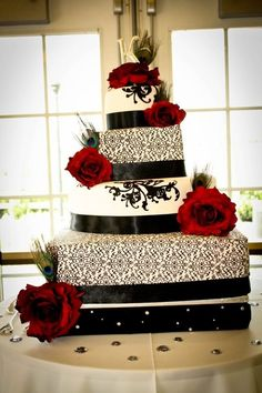 Black & White Demask Wedding Cake with Red Roses & Peacock Feathers