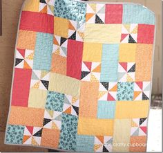 Pinwheel Baby Boy Quilt by the Crafty Cupboard.