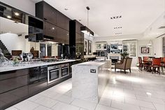 This is the kitchen I MUST have! The cabinets are to the ceiling, it is huge and open, and the island is great except it needs an overhang with stools!  I just LOVE it!  Stunnnig Victorian-Era Home Transformation in Melbourne from homedesign.