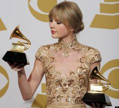 "Taylor Swift poses backstage with the awards for best country song and best country solo performance for ""Mean"" at the 54th annual Grammy Awards on Sunday, Feb. 12, 2012 in Los Angeles."