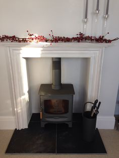 Pinterest inspired fire surround with Charnwood c5 in grey. So pleased!