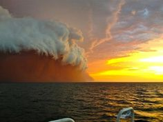 """Australia's Surreal Red Wave: """"On Wednesday, Western Australians were greeted with a shocking sight. A brewing thunderstorm suddenly built up off the coast of Onslow which moved reddish colored sand and dust from the land, into the air and out to the Indian Ocean. Tug boat worker Brett Martin quickly took some photos as did Levi Cooper, with his iPhone."""" - via My Modern Metropolis"""