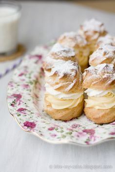 gorgeous cream puffs with pastry cream and whipped cream fillings then dusted with powdered sugar!