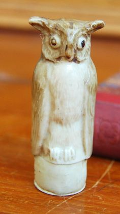 An+antique+Victorian+early+celluloid+owl+shaped+needlecase+with+three+bobbins+