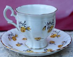 Staffordshire Tea Cup and Saucer Set. Footed Bone China Cup with Yellow Roses. Teacup Set Made in England.