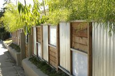great garden fence made of sheet metal and wood