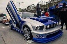 This is a cool Lambo door gray and blue mustang. I also love dodge challengers,and mustang Gt cobra jets. 😜