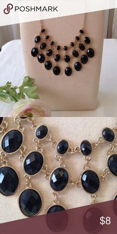 Black and Gold Statement Necklace Black faceted beads on a gold necklace. This is a statement piece! Beautifully set, no loose beads. Jewelry Necklaces