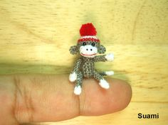 Miniature Sock Monkey With Pom Pom Hat  Micro Thread by suami,    Can't believe how small this is and she has many more!