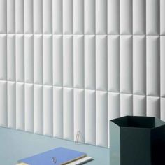 A series of white bodied wall tile comprised of opaque, geometric and three-dimensional surfaces. Biscuit Color, Stone Blocks, Tile Suppliers, Wall Installation, White Bodies, Web Design Company, Ravenna, White Tiles, Interior Walls