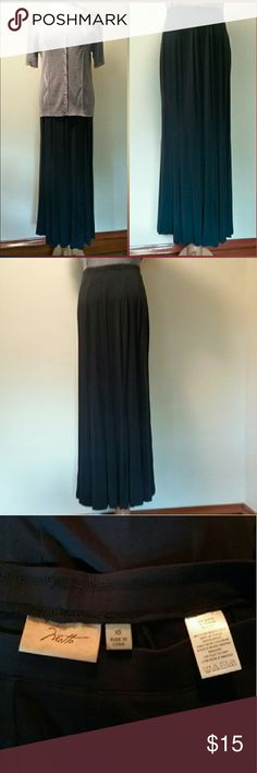 "Motto Dark Blue Maxi Skirt Never Worn This dark navy, soft, long flowing skirt with godets from Motto is in excellent shape. Though, it has indents from the skirt hanger on both sides of the waistband. It is made from 95% rayon & 5% spandex. It is machine washable. The measurement across the stretchable waistband is13"". It is 38"" long. It fits sizes 2-4. Motto Skirts Maxi"