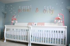 Baby Nursery:How To Make Pink Not To Be A Boring Color For Baby Cribs For Girls Nice Looking Nursery Room Design With Blue Wall Color And Twin White Nursery Cribs Also Corner White Standing Lamp Plus Hanging Pink Ornament Decor Idea