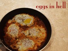Eggs in Hell - poached eggs in spicy tomato sauce.  So good!