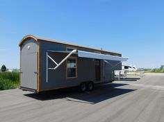 Tiny House Toy Hauler RV: A Tiny House on Wheels with a Garage?