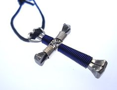 Blue & Silver Horseshoe Nail Cross Necklace - http://www.spiritualgemstonejewelry.com/blue-silver-horseshoe-nail-cross-necklace/