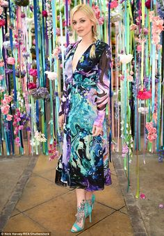Flower power! Flower power Fearne! TV's Fearne Cotton flashes a hint of side-boob in a plu...
