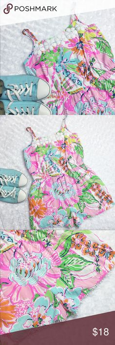 Lily Pulitzer romper Lily Pulitzer Nosey Posey Romper. This romper is so cute & versatile. Add a belt for an extra flare of wear it as is (no belt loops). A few of the pom poms on the bottom hem have come loose, please see the up close pictures. You could roll/stitch then back up, cut them off, or just leave them be. The crochet design on the chest is in perfect condition with no pulls or tears. Tiny stain on the seat, but is not noticeable when worn. *Please see first comment for additional…