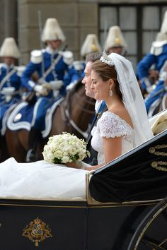 Christopher O'Neill and Princess Madeleine of Sweden are taken by horse and carriage from the Royal Palace of Stockholm to Riddarholmen after the wedding ceremony, 8 June 2013