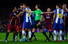 Luis Suarez of FC Barcelona (L) argues with RCD Espanyol players during the Copa del Rey Round of 16 first leg match between FC Barcelona and RCD Espanyol at Camp Nou on January 6, 2016 in Barcelona, Catalonia.