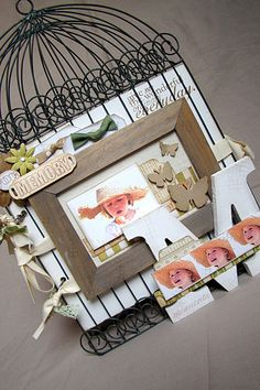 """Hobby Lobby has these """"flat"""" bird cages. Add some paper, frame and large letter and Voila....A Scrap lift."""