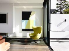 Egg chair; Brighton Townhouses / Martin Friedrich Architects