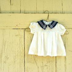 presentation of a baby dress for sale on Etsy