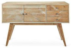 Made of reclaimed wood, this richly textured sideboard is a perfect marriage of rustic and Mid-Century Modern design.