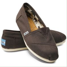 REDUCED  Chocolate Canvas Classic Slip-On TOMS NEW/never worn (tag was ripped off, but the plastic is still attached). A rich chocolate brown/grey color! Authentic lightweight slip-on with a leather footbed. Canvas upper/fabric and leather lining/rubber sole. No trades. TOMS Shoes