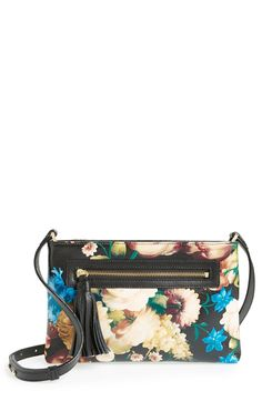 Love the tassel-embellished zipper on this cute floral crossbody bag.