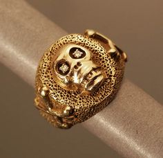 Gold scull ring, from our Metro Online auctions.