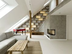Normally I'm a fan of corners, but this rounded loft in Prague, Czech Republic isn't too shabby.