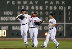 4/25/13  Boston Red Sox outfielders, from left, Jacoby Ellsbury, Jonny Gomes and Daniel Nava celebrate after defeating the Houston Astros 7-2 in a baseball game in Boston. (AP Photo/Michael Dwyer)
