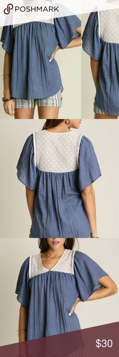 Umgee Top Size S M L Tunic Blue White Lace .  Short sleeve top. .  Fringe detail along lace edge. .  Crinkle material. .  High and low bottom. .  65% Cotton, 35% Polyester. .  No perfumes, scents, or unwrinkle sprays added, still in factory packaging. Laying flat, unstretched:  Size SMALL, Bust measures 23 inches, waist 36,  overall length 32. To get approximate sizes, add an inch onto bust and waist measurements for MEDIUM and 2 inches for LARGE. Umgee Tops Blouses