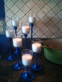 old brass candlesticks reinvented with a little blue spray paint with votive holders hot glued to the top of each one : )  Nice, easy project to liven up any get together : )