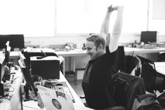 Man Stretching Arms during Break Time at Office When we think about fitness, many of us stretch only before a workout. However, stretching is more important than you think, especially if you spend the majority of your day sitting at a desk.Take a moment