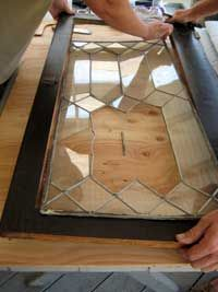 How to Repair Leaded Glass: Learn to repair your home's old leaded glass by following along with a fearless DIYer. Story and photos by Lynn Elliott.