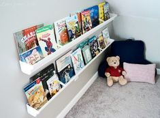 Love this idea - using gutters for bookshelves. A DIY bookshelf made with a rain gutter - Ganz Parent Club Guest Post