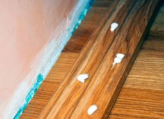 When a length of molding falls off, a corner of carpet comes up, or a tile comes loose, it's good-old all-purpose caulk that can fix it. Dab a little behind the loose material, then stick it back into place. You can even use all-purpose caulk to install wood paneling without nails!