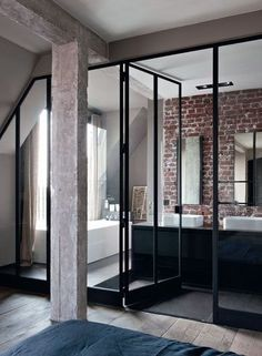 loving glass doors, exposed brick and cement pillars