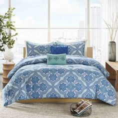 The Intelligent Design Lana Comforter Set provides a modern take on bohemian chic. Printed on microfiber, this unique pattern features large medallions with intricate design work inside using bold blues and greens.