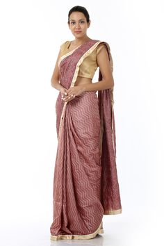 A rustic silk sari fashioned in kosa silk fabric with a unique design and finish. This flattering creation is enhanced with intricately placed patterns all over and comes with a complimenting blouse piece.