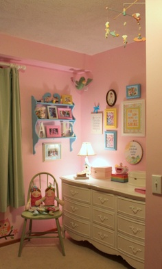 Big Girl Room by TaDa!Creations... She loves the chair with dolls and shelf with photos.