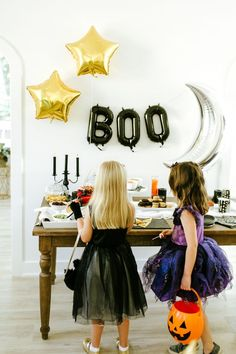 Ideas for throwing the perfect Halloween party for ghosts & goblins of all ages, with DIY projects, an easy Halloween menu, & inexpensive decor from Target.