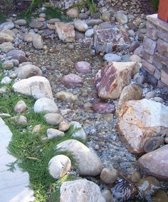 "Photo by Doug Kalal, taken at a client's garden in Tierrasanta.  This lovely stream wraps around a small patio and ends in a ""pondless"" rock..."