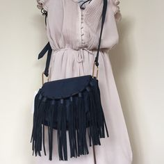 """Vegan Leather Blair Fringe Fold over crossbody bag Fold over fringe cross-body bag made from Vegan Leather. An animal cruelty free purchase along with a bag that holds your personal belongings, makes a statement and is a trendy/ Fashion Forward accessory. Brand new with tags. Never worn. Navy Blue. Aprox 19"""" Strap drop Melie Bianco Bags Crossbody Bags"""
