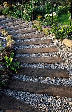 Railway timbers and pea gravel path... Your home should be decorated to make you smile and surround you with memories. I never want to forget the countless hours of playing trains on the living room floor with my 3 year old. i imagine every time I walk down this path I would remember his silly obsession with chop choos as a toddler.