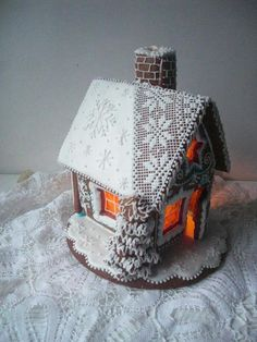 Gingerbread house with lace embroidery roof  http://cookieconnection.juliausher.com/blog/saturday-spotlight-best-of-christmas-cookies