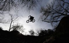 Daily Life: February 2013 http://bo.st/168L2uE   A cyclist flies through the trees as he jumps a dirt mound at a bike park on Feb. 26 in Austin, Texas. (Eric Gay/Associated Press)     via The Big Picture Boston