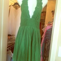 Catherine Malandrino Dress You will want this stunner in your closet . Be the head turner this summer in this green low v neckline with exquisite eyelet halter ties. Photo does not show the true beauty of this high end designer dress. Catherine Malandrino Dresses